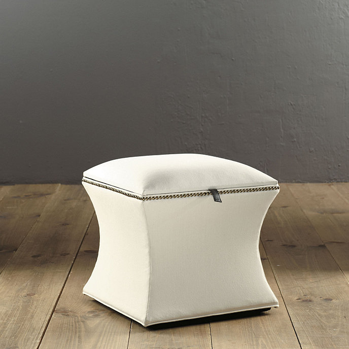Courbe storage ottoman with antique brass nailheads